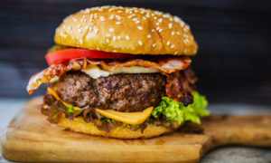 Burger, Beef Burger with Bacon on wood Board