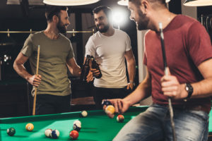 friends playing pool, drinking beer