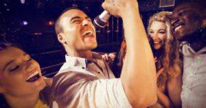 man doing karaoke, friends doing karaoke